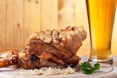 Knuckle of pork. Bavarian knuckle of pork with beer Royalty Free Stock Image