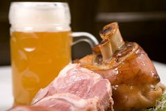 Knuckle of pork with beer. A close-up of knuckle of pork with beer Stock Image