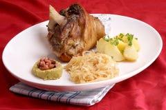 Knuckle of pork and  organic sauerkraut Stock Photography