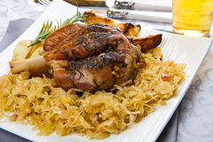 Knuckle of pork with sauerkraut Royalty Free Stock Images