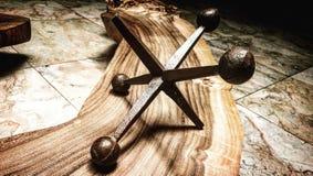 Knucklebones jack on wood surface stock photo