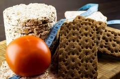 Knuspriges Brot und Tomaten Stockbilder