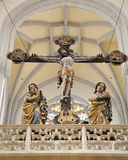 Košice - Carved cross and Virgin Mary ans st. John statue from year 1420 Stock Photo