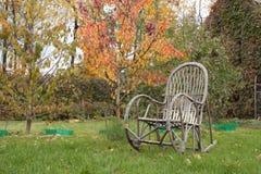 Kołysać krzesła na trawie Fotografia Royalty Free