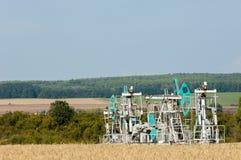 Kołysa olej dzień Czerwiec Kazakhstan miesiąc olej pompuje western Przemysł paliwowy equipment Styczeń 33c krajobrazu Rosji zima  Zdjęcie Royalty Free