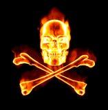 kości krzyżują płomienną czaszkę Fotografia Royalty Free