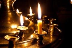 kościelne płonące świeczki Fotografia Royalty Free