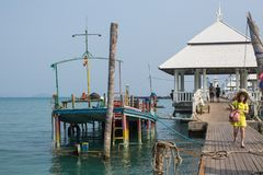Sunken ship near pier of Bang Bao fishing village, which consists of houses on stilts built into the sea. Stock Photo