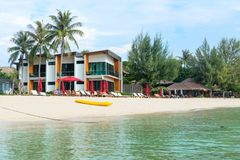 Seaview hotel with sunbeds and umbrellas on a clean tropical san. KO LIPE, THAILAND - APR 2017: Seaview hotel with sunbeds and umbrellas on a clean tropical sand Stock Image