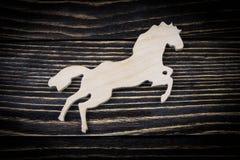Koń na starym drewnianym tle Obraz Stock
