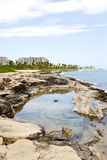 Ko'Olina Lagoon Rocks. View of the Koolina resort from the rocks at the shoreline stock images