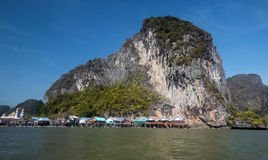 Ko Panyi,Phang-Nga Province,Thailand. A scenic seascape of Muslim fishing village on stilts against the limestone karst mountains in beautiful Ao Phang-Nga Royalty Free Stock Image
