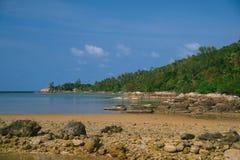 Ko Pha-ngan beach. Thailand, Ko Pha-ngan, stony beach at low tide time Royalty Free Stock Photos