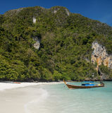 Ko Phi Phi Island - Thailand. Long-tailed boat moored on a tropical beach in a secluded cove on Ko Phi Phi Island near Phuket in Thailand Royalty Free Stock Photos