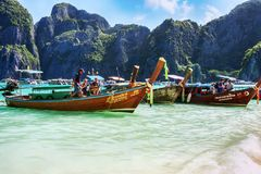 Typical Thai vessels used for tourists transport, moored om Ko Phi Phi Lee island in Thailand. Ko Phi Phi Lee, Thailand July 06,2017 :Typical Thai vessel used Stock Image