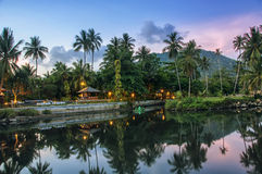 Ko Samui in the evening. Summer resort at Ko Samui, Thailand. Little bungalow hidden in the trees with water at sunset stock photos