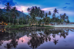 Ko Samui in the evening. Summer resort at Ko Samui, Thailand. Little bungalow hidden in the trees with water at sunset royalty free stock photography