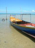 Ko samui fishing boat. A colourful fishing boat, rests in the shallow waters of Lamai beach, Koh Samui, Thailand Stock Image