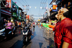 KO SAMUI, THAILAND - APRIL 13: Chaweng Main Road at the celebration of the water fight festival or Songkran Festival Stock Photos