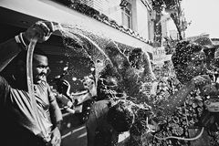 KO SAMUI, THAILAND - APRIL 13: Unidentified man hosing people on Songkran Festival. (Thai New Year) on April 13, 2014 in Chaweng Main Road, Ko Samui island royalty free stock photo