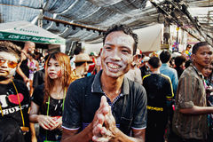KO SAMUI, THAILAND - APRIL 13: Unidentified man in a thai pose of sawadee krap on Songkran Festival. (Thai New Year) on April 13, 2014 in Chaweng Main Road, Ko royalty free stock images