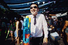 KO SAMUI, THAILAND - APRIL 13: Unidentified man with a watergun on Songkran Festival Royalty Free Stock Photos