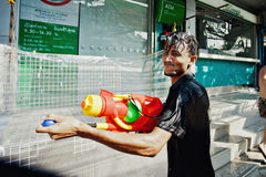 KO SAMUI, THAILAND - APRIL 13: Unidentified man with a watergun in a water fight festival or Songkran Festival Royalty Free Stock Image