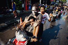 KO SAMUI, THAILAND - APRIL 13: Unidentified people on a bike in Songkran Festival Royalty Free Stock Images