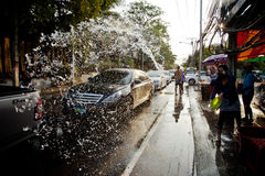 KO SAMUI, THAILAND - APRIL 13: Unidentified people shower water on Songkran Festival Stock Photography