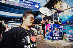 KO SAMUI, THAILAND - APRIL 13: Unidentified smeared man in a water fight festival or Songkran Festival Stock Image