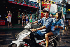 KO SAMUI, THAILAND - APRIL 13: Unidentified thai people on a bike on Songkran Festival (Thai New Year) Royalty Free Stock Photo