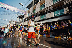 KO SAMUI, THAILAND - APRIL 13:  Unidentified walking man on Songkran Festival. (Thai New Year) on April 13, 2014 in Chaweng Main Road, Ko Samui island, Thailand Royalty Free Stock Photography