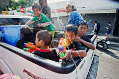 KO SAMUI, THAILAND - APRIL 13: Unidentified young thai small children in the trunk of a pickup in a water fight festival or Songkr Royalty Free Stock Image