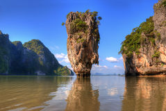 Ko Tapu island. In Thailand with reflection in water Royalty Free Stock Photography