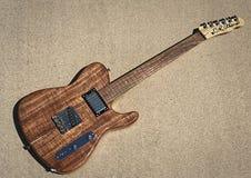 Koa CR Alsip Tejas T E-Gitarre Stockbild
