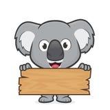 Koala die een plank van hout houden vector illustratie