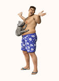 Koala Hugging Tummy Overweight Man. A koala hugging on to the tummy of an overweight man Stock Photos
