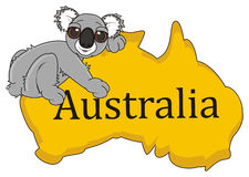Koala lying top on the continent Australia. Funny gray koala smiling and huging continent Australia Stock Photography