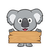 Koala que sostiene un tablón de la madera ilustración del vector
