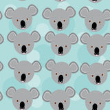 Koala Seamless pattern with funny cute animal face on a blue bac Royalty Free Stock Photo