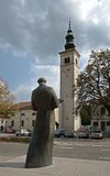 Kobarid, Slovenia. Square with sculpture and church in town Kobarid, Slovenia Stock Photography