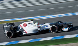 Kobayashi Test Driving his F1 Sauber Racing Car Royalty Free Stock Images