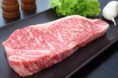 Kobe beef. With garlic, salt and pepper Royalty Free Stock Photography