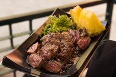 Kobe beef steak. Juicy Kobe beef steak with pineapple and spring onion royalty free stock photos
