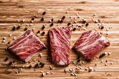 Kobe Beef on wooden board with pepper and salt Stock Image