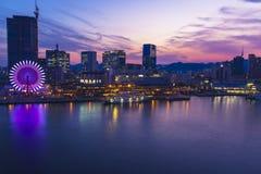 Kobe harbor at night with ferris wheel and boat Stock Image