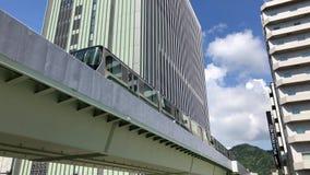 Kobe Port Liner. The driverless Kobe Port Liner leaving Sannomiya Station in Kobe city, Japan stock footage