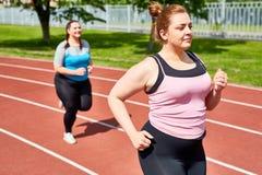 Kobiet biegać Zdjęcia Royalty Free