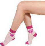 Kobiet nogi w skarpetach pojedynczy białe tło zdjęcia stock