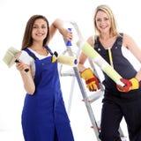 Kobiet szczęśliwi ufni decorators Zdjęcia Royalty Free